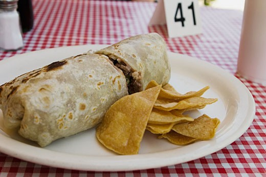 Stock Photo: 1757R-1444 Front view of burrito and chips.