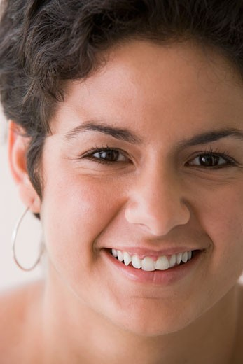 Close up portrait of young woman smiling : Stock Photo