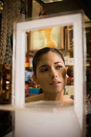 Woman sampling cosmetics in beauty store : Stock Photo