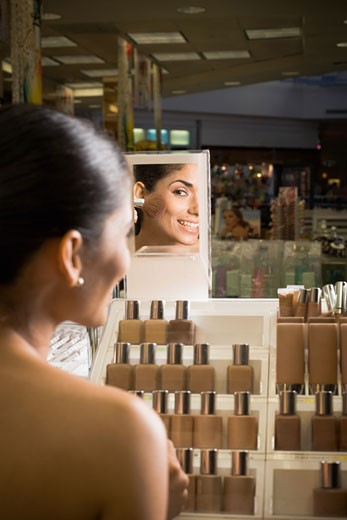 Stock Photo: 1757R-2046 Woman sampling cosmetics in beauty store