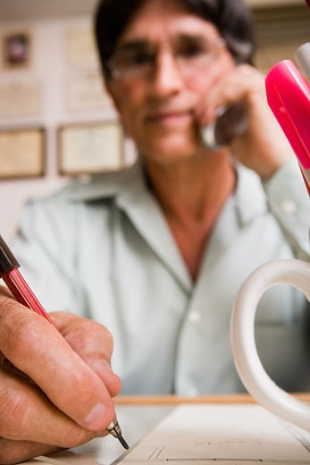 Stock Photo: 1757R-2313 Architect working in home office