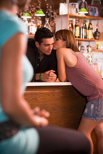 Stock Photo: 1757R-2916 Young woman socializing with bartender