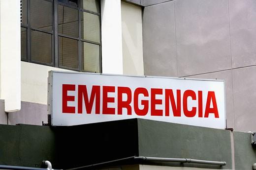 Emergency sign, Spanish : Stock Photo