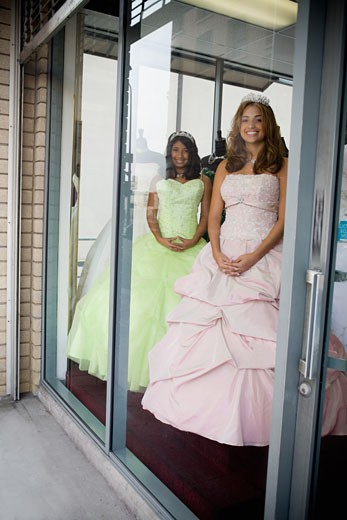 Stock Photo: 1757R-3419 Girls posing as mannequins in dress shop window