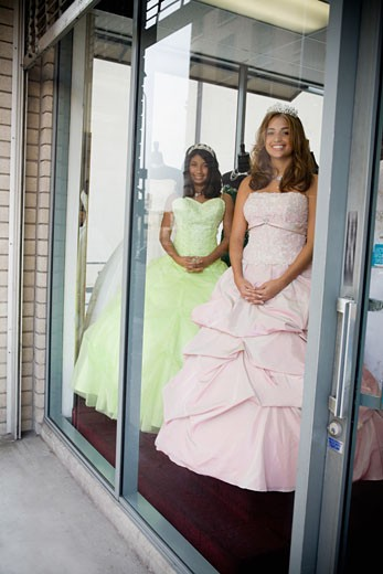 Stock Photo: 1757R-3420 Girls posing as mannequins in dress shop window
