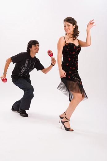 Stock Photo: 1757R-3678 Studio portrait of couple dancing