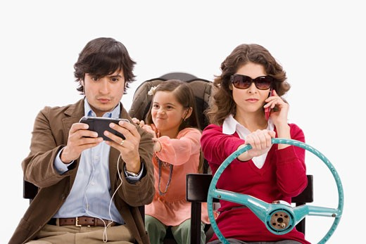 Distracted family in imaginary car : Stock Photo