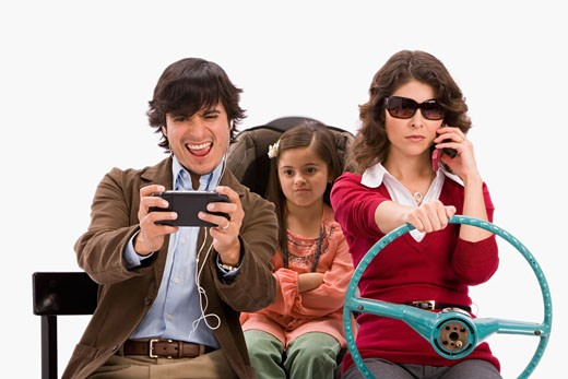 Stock Photo: 1757R-3792 Distracted family in imaginary car