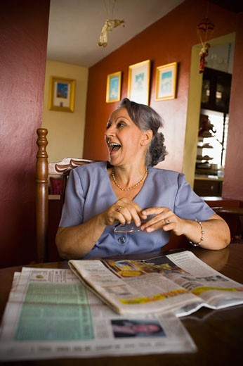 Stock Photo: 1757R-3943 Mature woman looking away and laughing