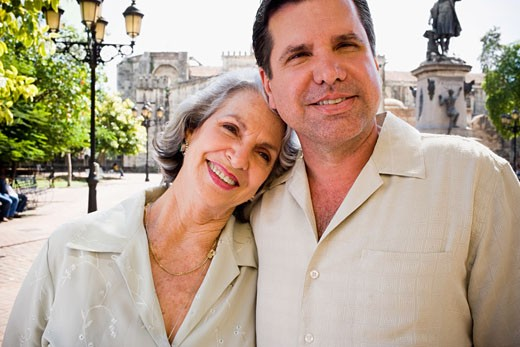 Close-up of a senior woman with her son smiling : Stock Photo
