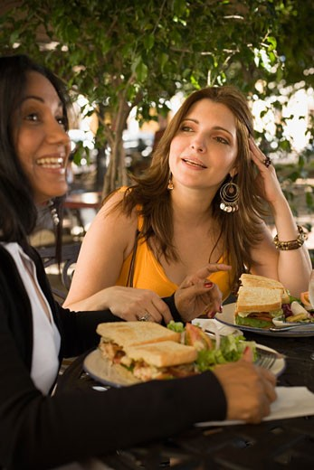 Two women sitting in a restaurant : Stock Photo