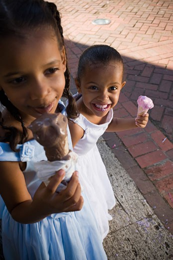 High angle view of two girls eating ice creams : Stock Photo