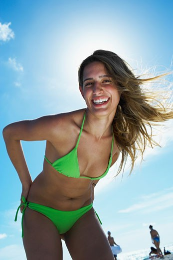 Young woman smiling on beach : Stock Photo