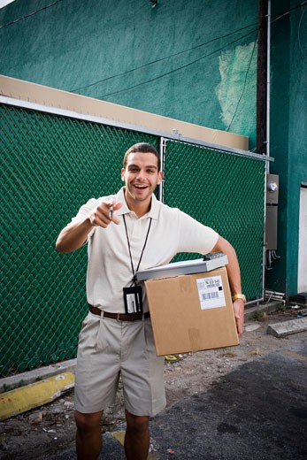 Delivery man making deliveries : Stock Photo