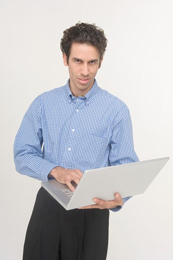 Man holding laptop : Stock Photo