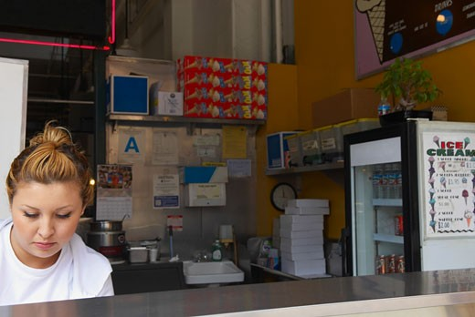 Stock Photo: 1757R-6138 Close-up of a female ice-cream shop owner