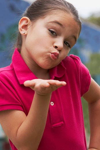 Portrait of a girl blowing kisses : Stock Photo