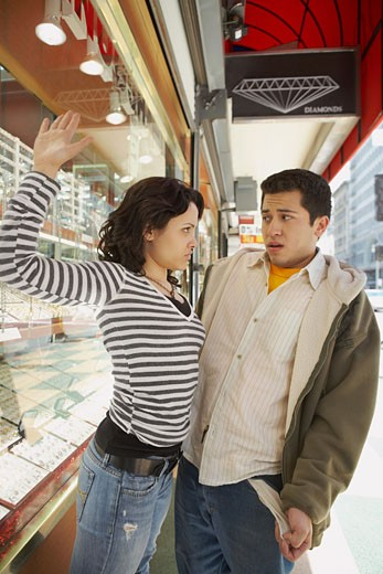 Stock Photo: 1757R-7002 Young woman slapping her boyfriend in a jewelry store