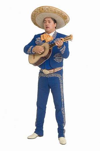 Portrait of Mariachi playing guitar and singing : Stock Photo