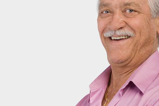 Portrait of a senior man smiling : Stock Photo