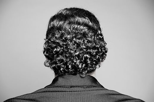 Back of businessman's head, curly hair : Stock Photo