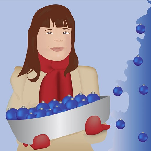 Girl holding a tray of Christmas ornaments : Stock Photo