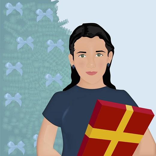 Girl holding a Christmas present : Stock Photo