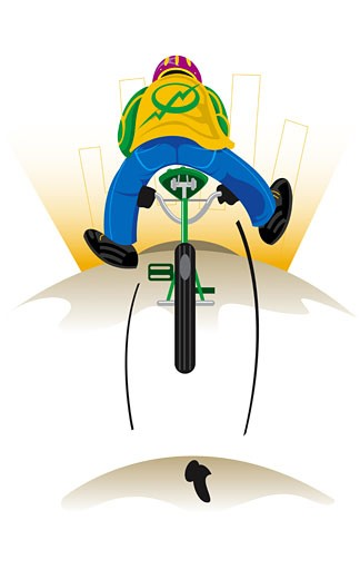 Rear view of a boy riding a bicycle : Stock Photo