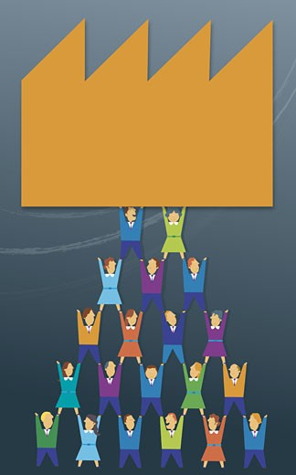 Business executives forming a human pyramid : Stock Photo