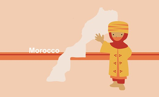 Boy in traditional clothing near map of Morocco : Stock Photo