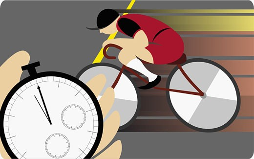 Stock Photo: 1758R-6001 Hand holding a stopwatch and a man cycling in background