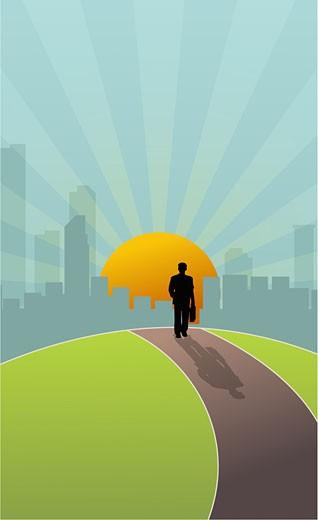 Stock Photo: 1758R-6579 Businessman walking towards a city at sunset