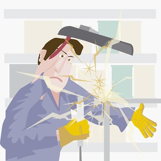 Welder welding an iron rod : Stock Photo