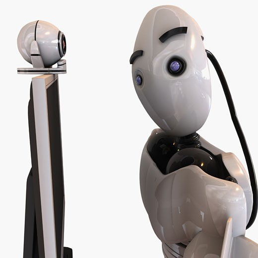 Robot looking at a video conference camera : Stock Photo