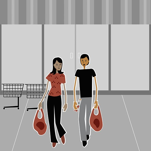 Stock Photo: 1758R-7079 Young couple carrying shopping bags