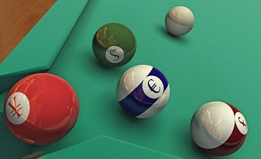 Currency signs on cue balls : Stock Photo