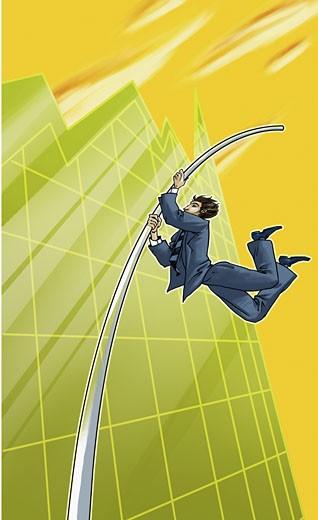Businessman pole vaulting on a line graph : Stock Photo