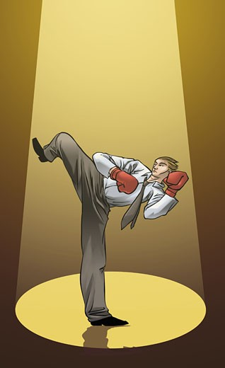 Businessman practicing kickboxing : Stock Photo