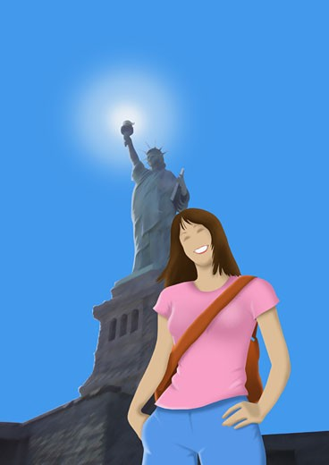 Woman smiling and standing in front of a monument : Stock Photo