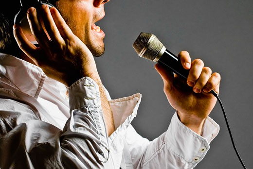 Stock Photo: 1758R-8361 Man singing into a microphone
