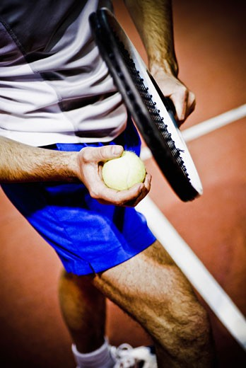 Stock Photo: 1758R-8379 Tennis player playing tennis in a court