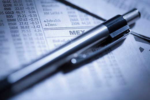 Close-up of a pen on a stock market report : Stock Photo