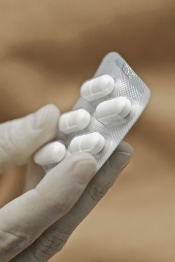 Stock Photo: 1758R-8504 Close-up of a person's hand holding a blister pack