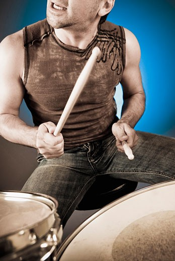 Man playing drums : Stock Photo