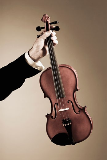 Stock Photo: 1758R-8566 Man's hand holding a violin
