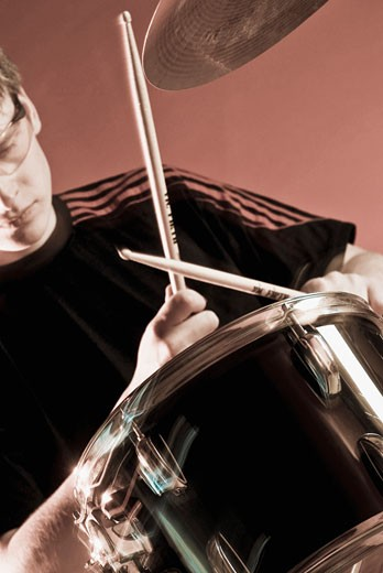 Stock Photo: 1758R-8596 Close-up of a man playing drums