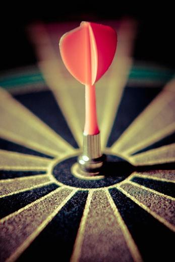 Close-up of a dart on a dartboard : Stock Photo