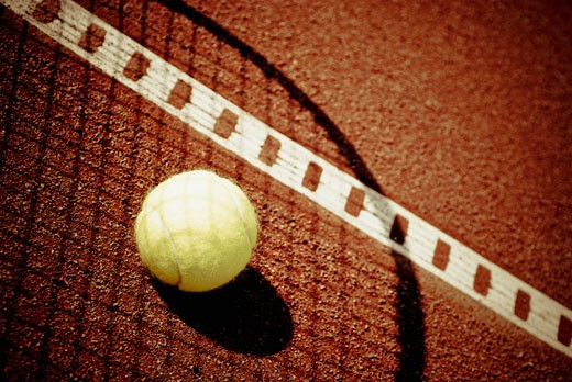 Tennis ball on shadow of a tennis racket : Stock Photo