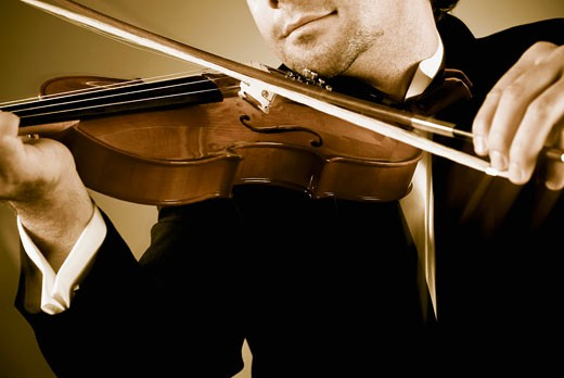Stock Photo: 1758R-8709 Man playing a violin