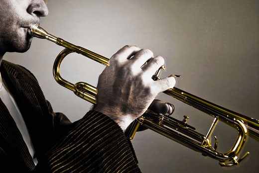 Stock Photo: 1758R-8750 Man playing a trumpet